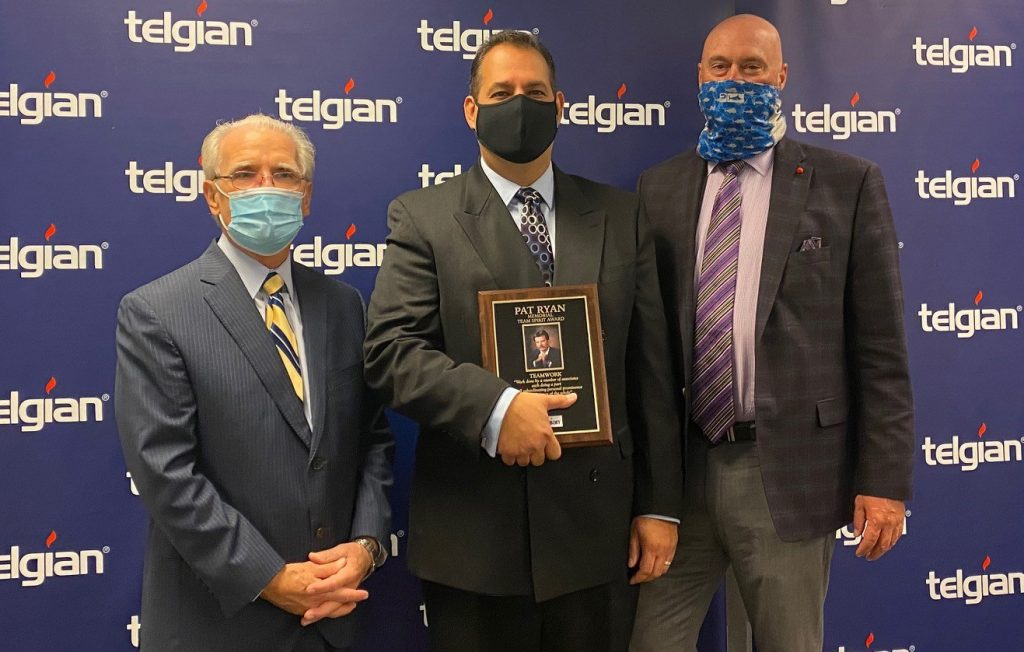 Branko Mitkovski (center) is the recipient of the 2020 Telgian Pat Ryan Team Spirit Award. Mitkovski is pictured here (center) with Telgian Executive Chairman Russell Leavitt and CEO James Tomes (left to right).